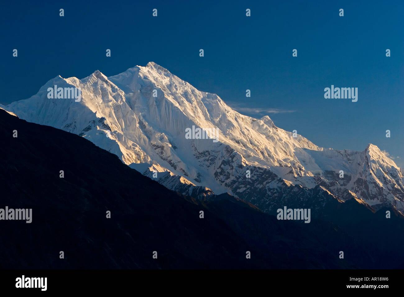 The splendid peak of Mt Rakaposhi at sunset viewed from Karimabad Pakistan - Stock Image