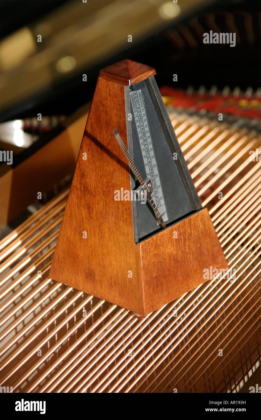 Metronome on a Piano - Stock Image