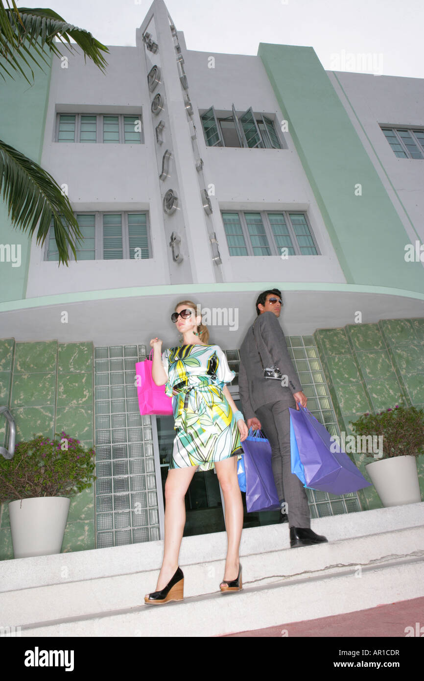 Fashionable couple with shopping bags. - Stock Image
