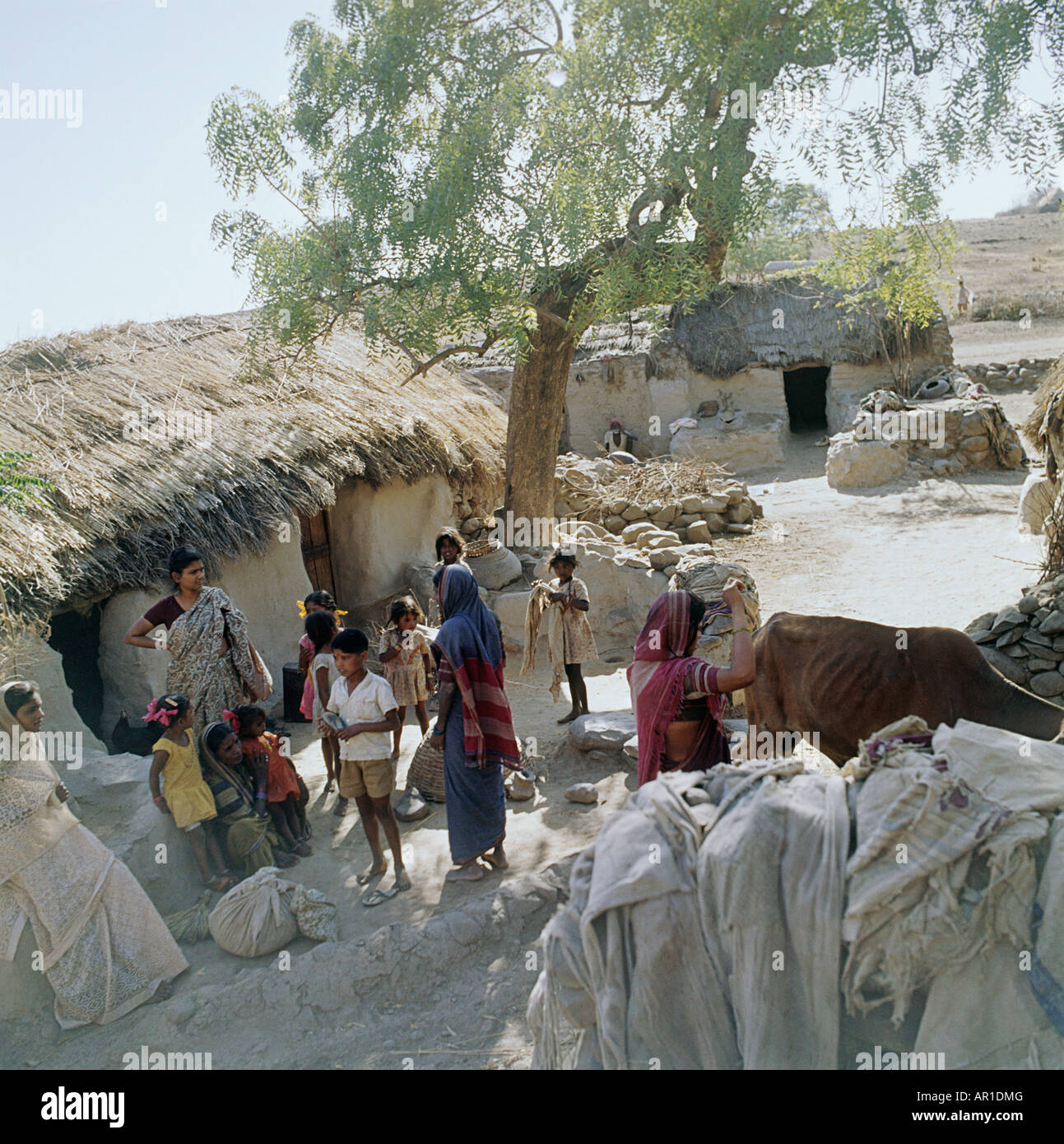 An Indian village people gather.This is near Ahmednagar. They are Untouchables, or Harijans, are outside the confines - Stock Image