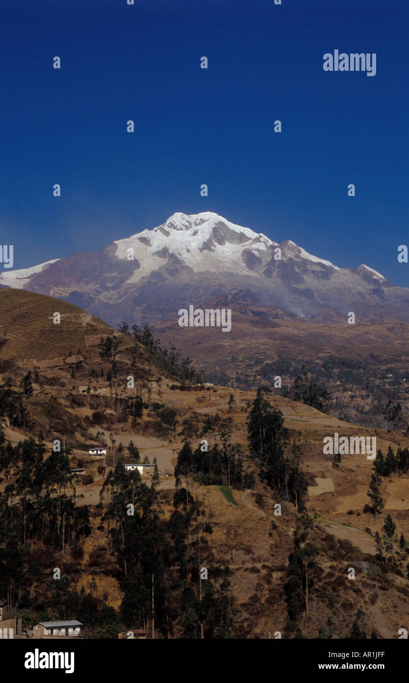 Snow capped Mount Illampu with the altitude of 6700 meters above the town of Sorata Bolivia - Stock Image