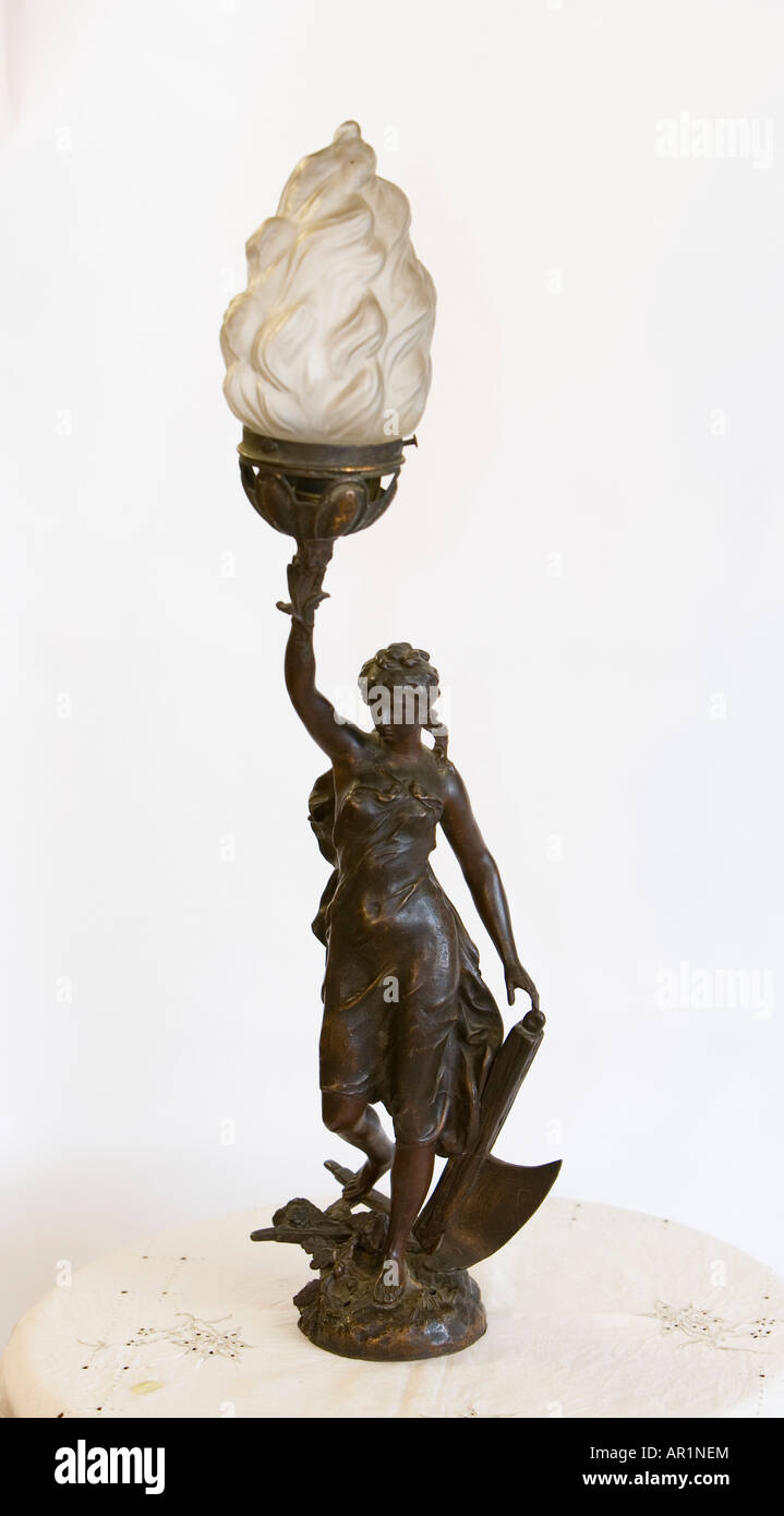 bronze lady with lamp - Stock Image