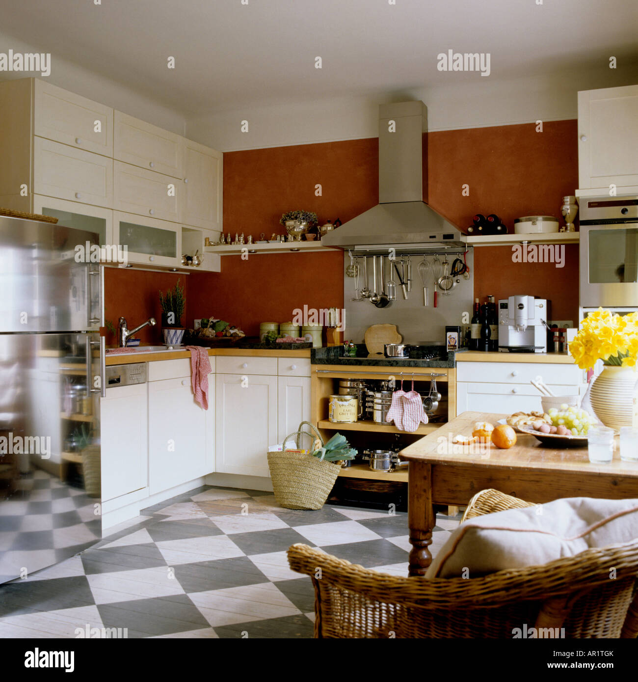 fitted kitchen with checkerboard floor Stock Photo