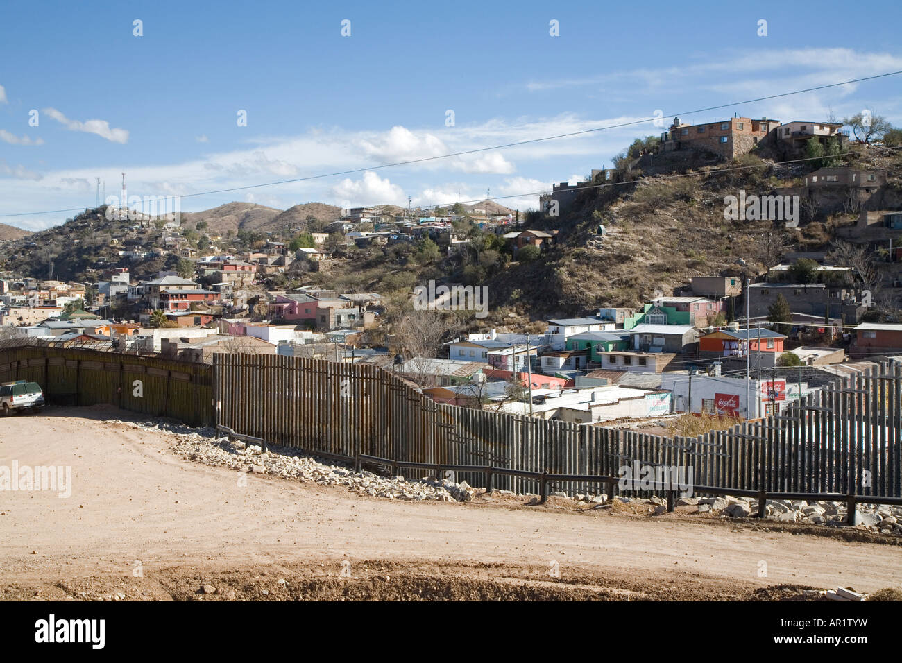 Nogales Arizona A section of the border fence that separates the United States in the foreground from Mexico Stock Photo