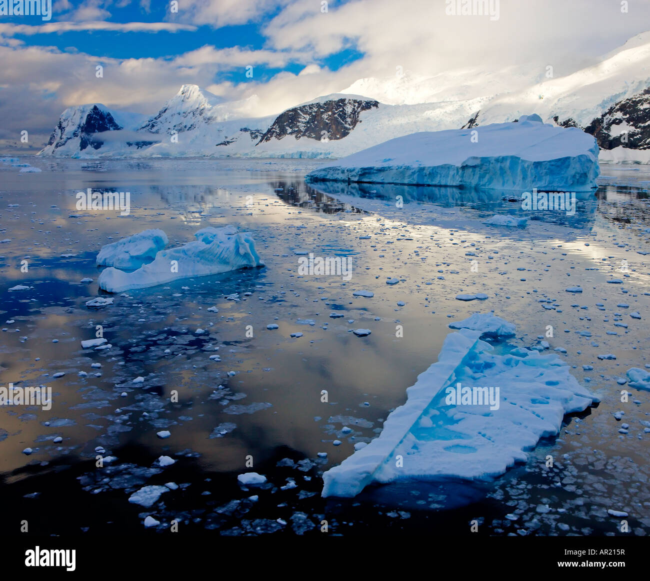 Icebergs and mountains along the Antarctic Peninsula - Stock Image