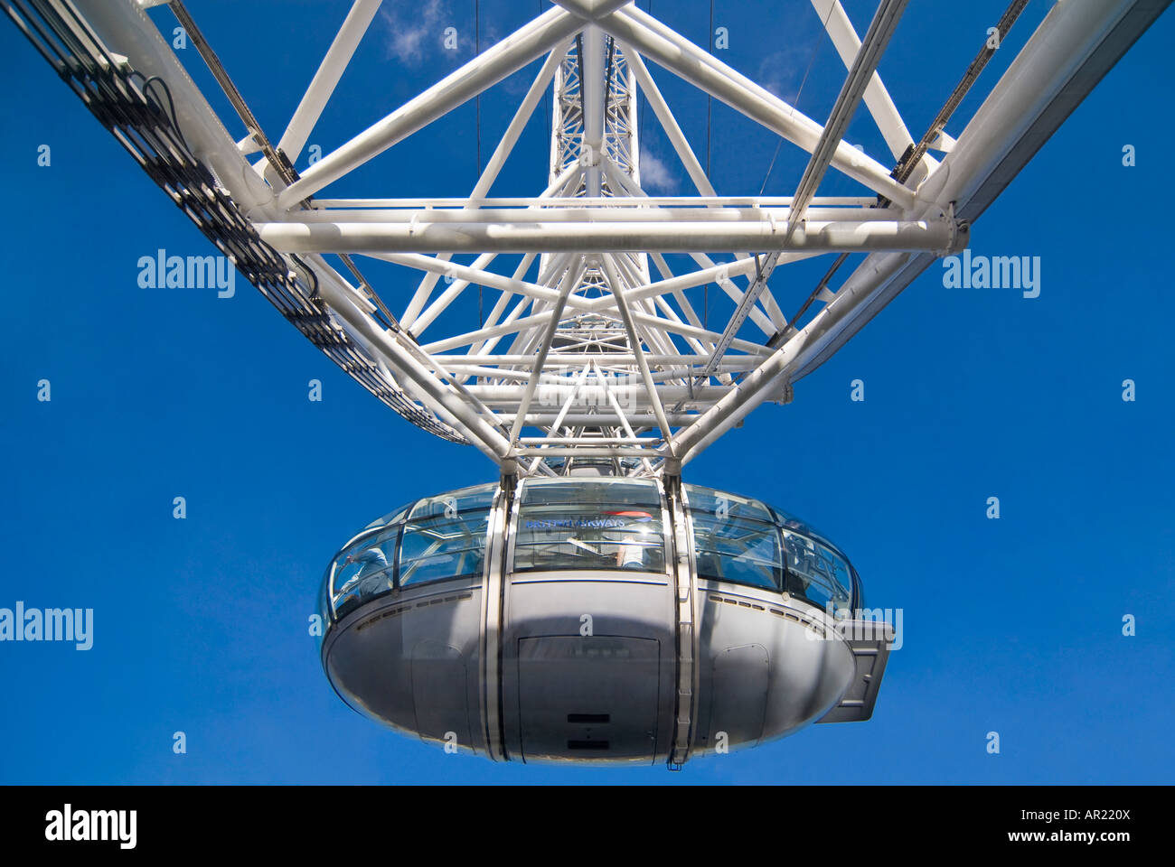 Horizontal close up of one capsule carrying passengers on a rotation of the London Eye Millennium wheel on a bright Stock Photo