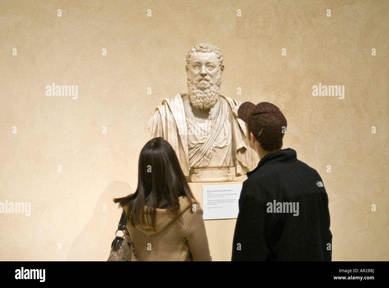 Young Couple Admiring a Marble Bust of Francesco Bocchetta at the Metropolitan Museum of Art in New York City - Stock Image