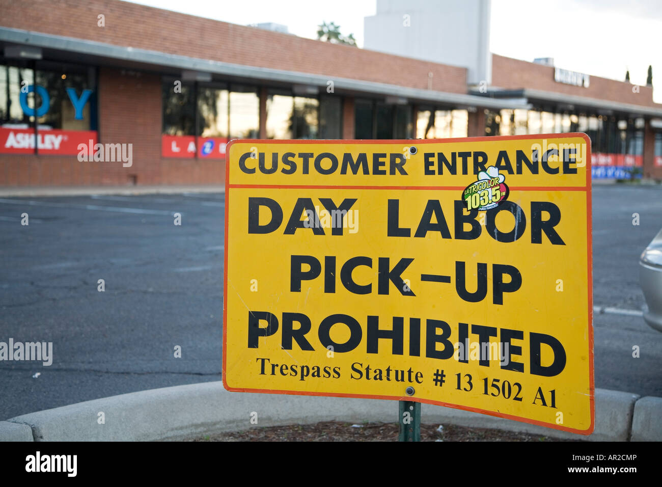 Sign prohibits pick up of day laborers in parking lot - Stock Image
