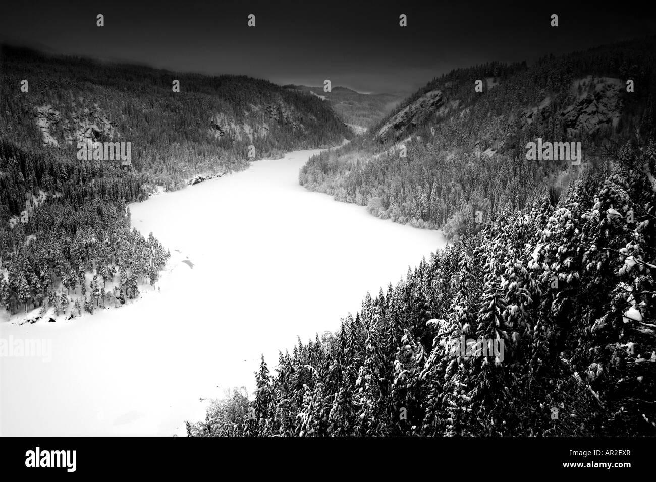 Snowy winter landscape with dark skies, in Aurdal valley, Valdres, Norway. - Stock Image