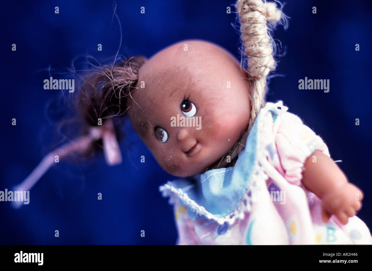 Scuffed, black doll in noose. Hate crime. - Stock Image