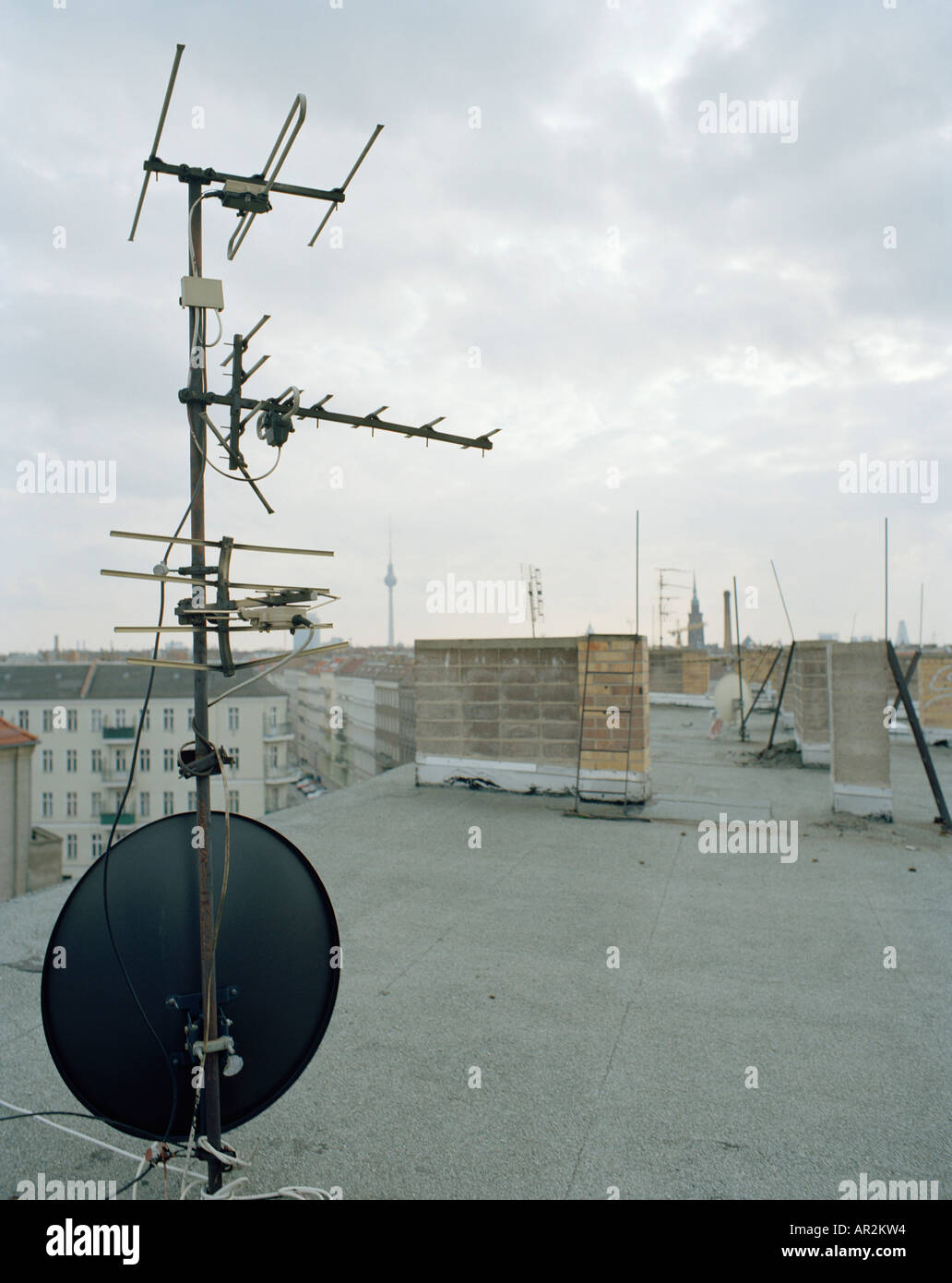TV aerial and satellite dish on apartment roof Stock Photo ...