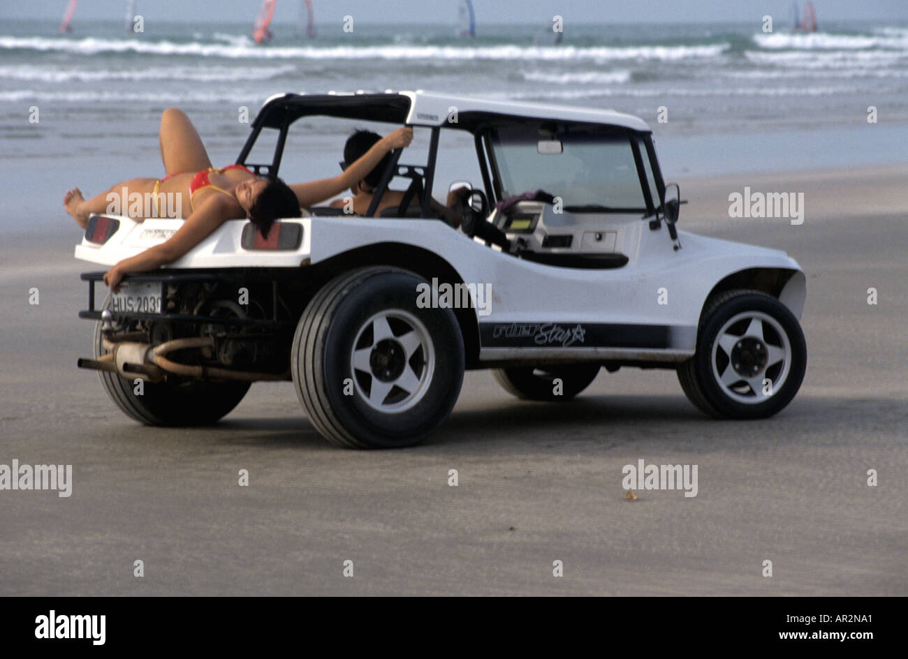Beach Buggy Vw >> Brazilian sun worshipper lounging on beach buggy, Jericoacoara Stock Photo: 5197216 - Alamy