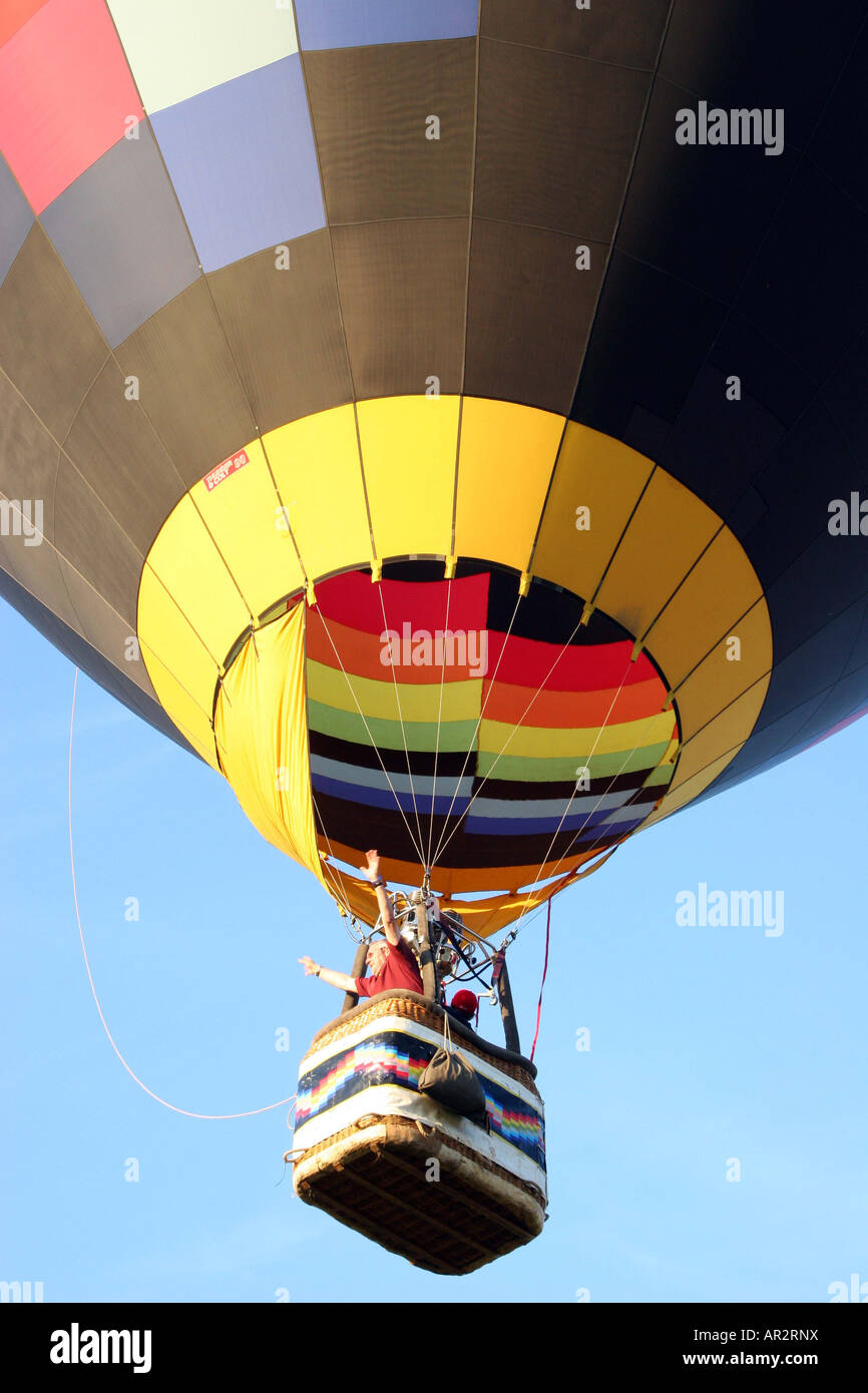 hot air ballon flying high in the sky, into the blue sky. G-SUED multicolored patchwork Stock Photo