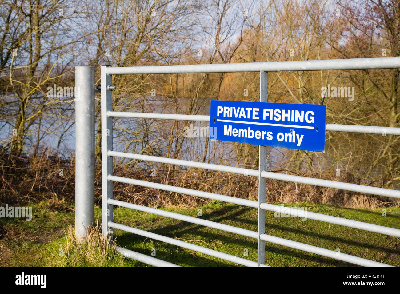 Gate to a private fishing area. Members only. Hampshire. UK. - Stock Image