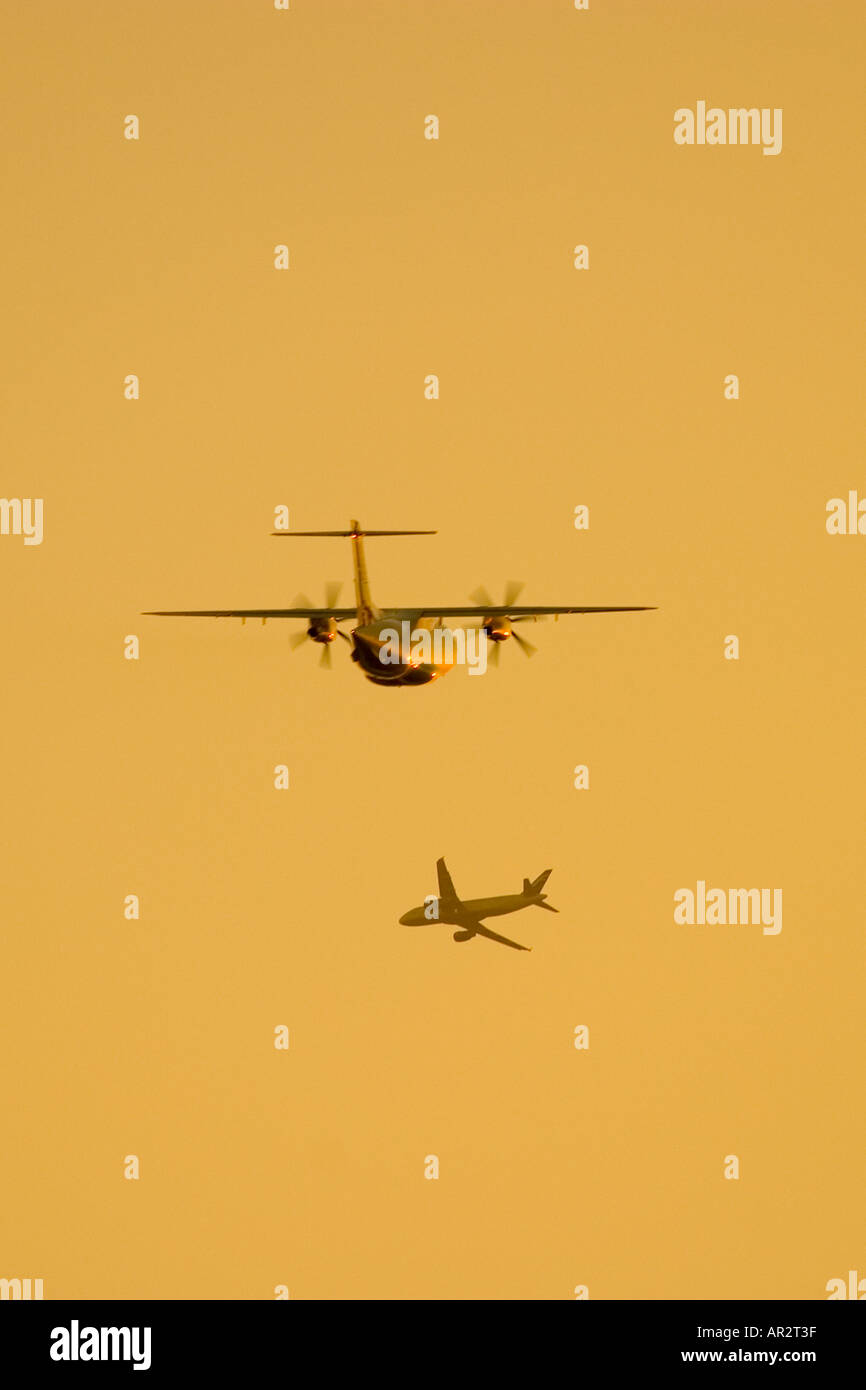 Two Aeroplanes flying close - Stock Image