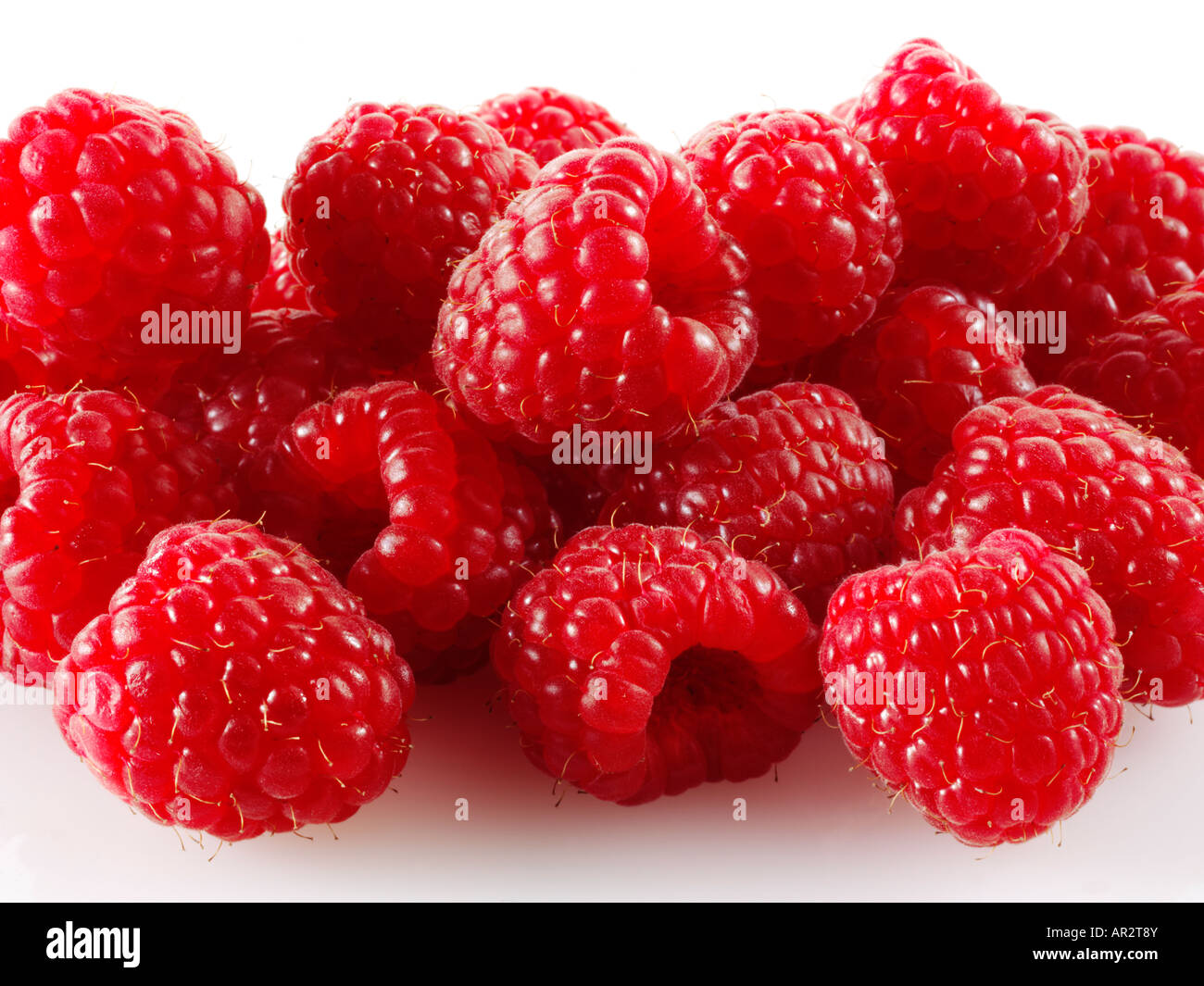 pile of Raspberries on a white background - Stock Image