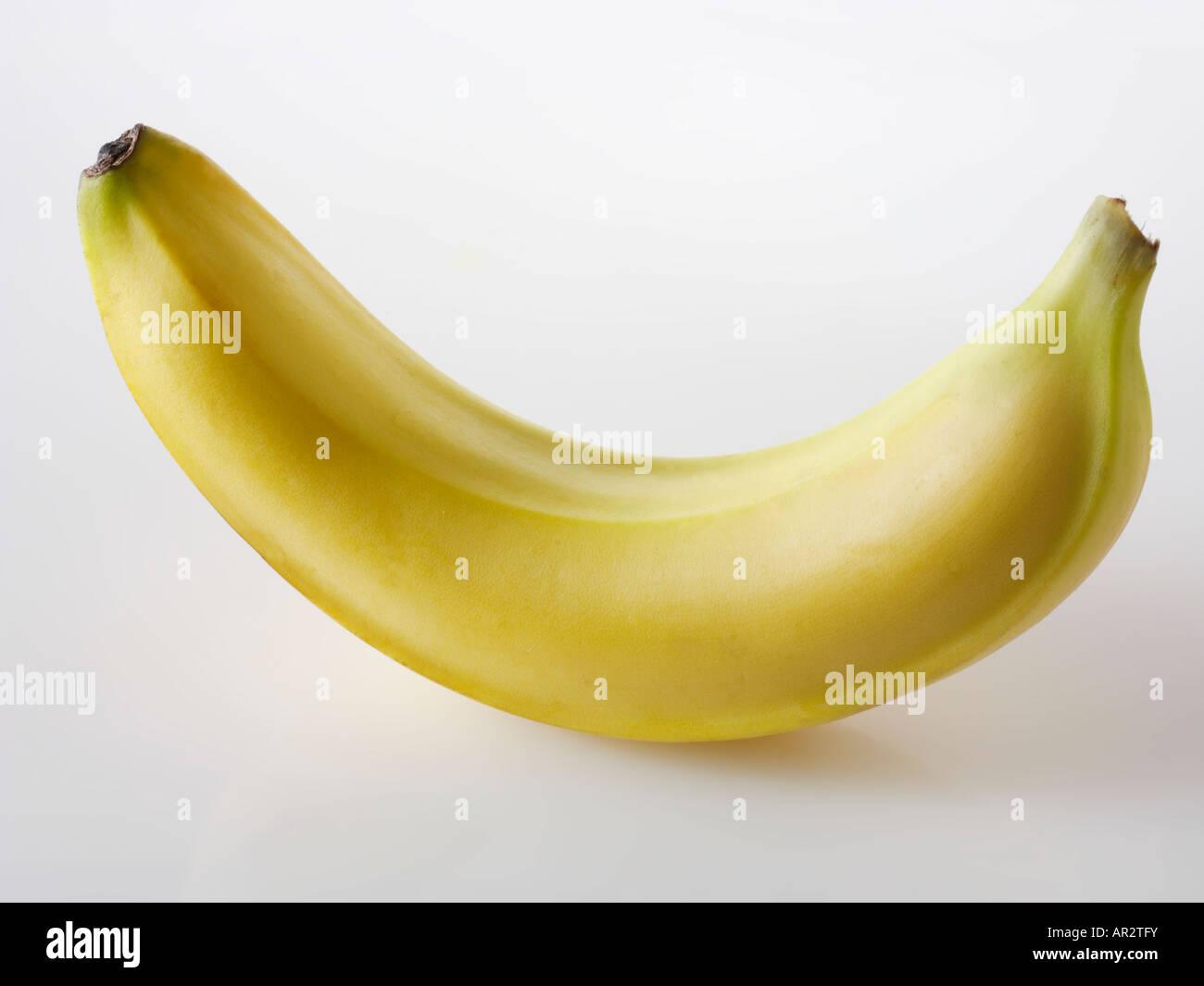 un-peeled Banana - Stock Image