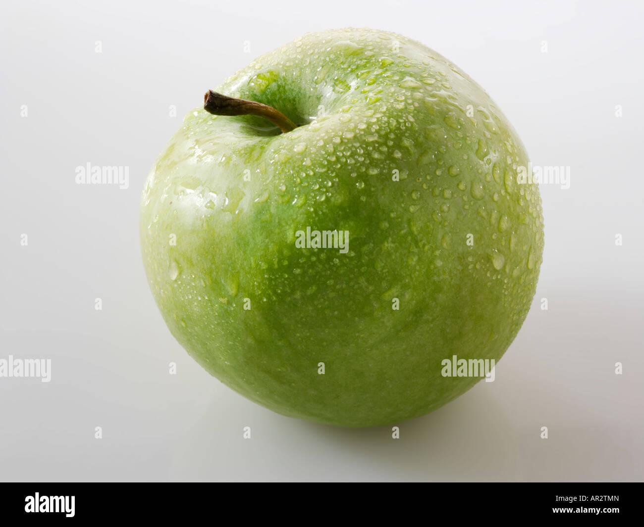 uncut green apple. Golden Delicious - Stock Image