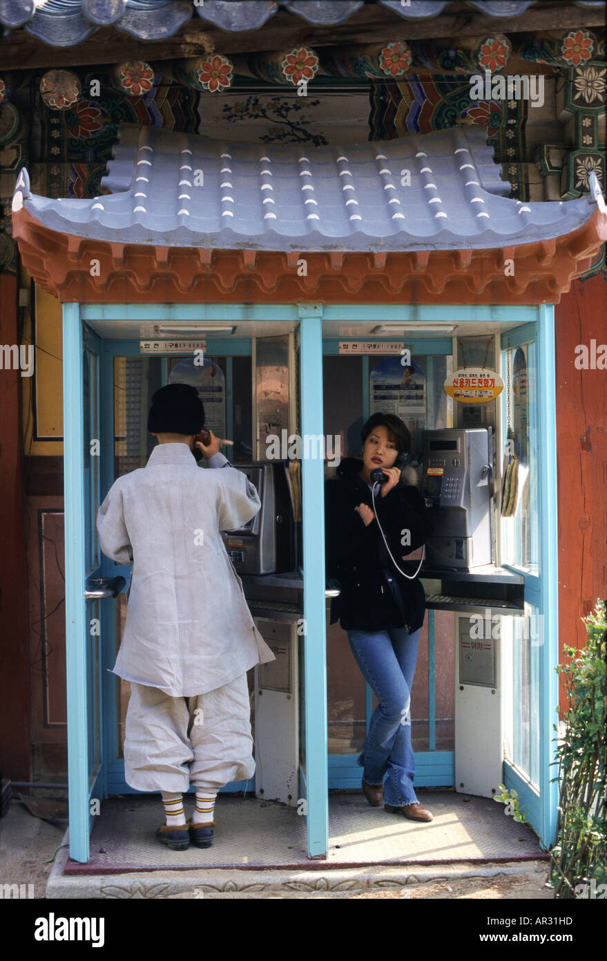 Monk and woman, telephone booth in Haein-sa monast, Haein-sa, Kayasan National Park South Korea, Asia - Stock Image