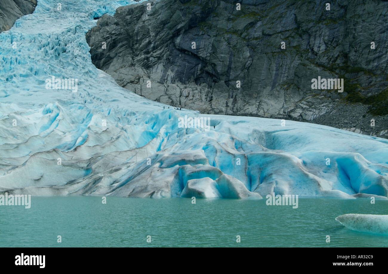 glacial blue lake at the bottom of the Briksdalbreen Glacier Olden Valley Sogn og Fjordane Fjordland West Norway - Stock Image