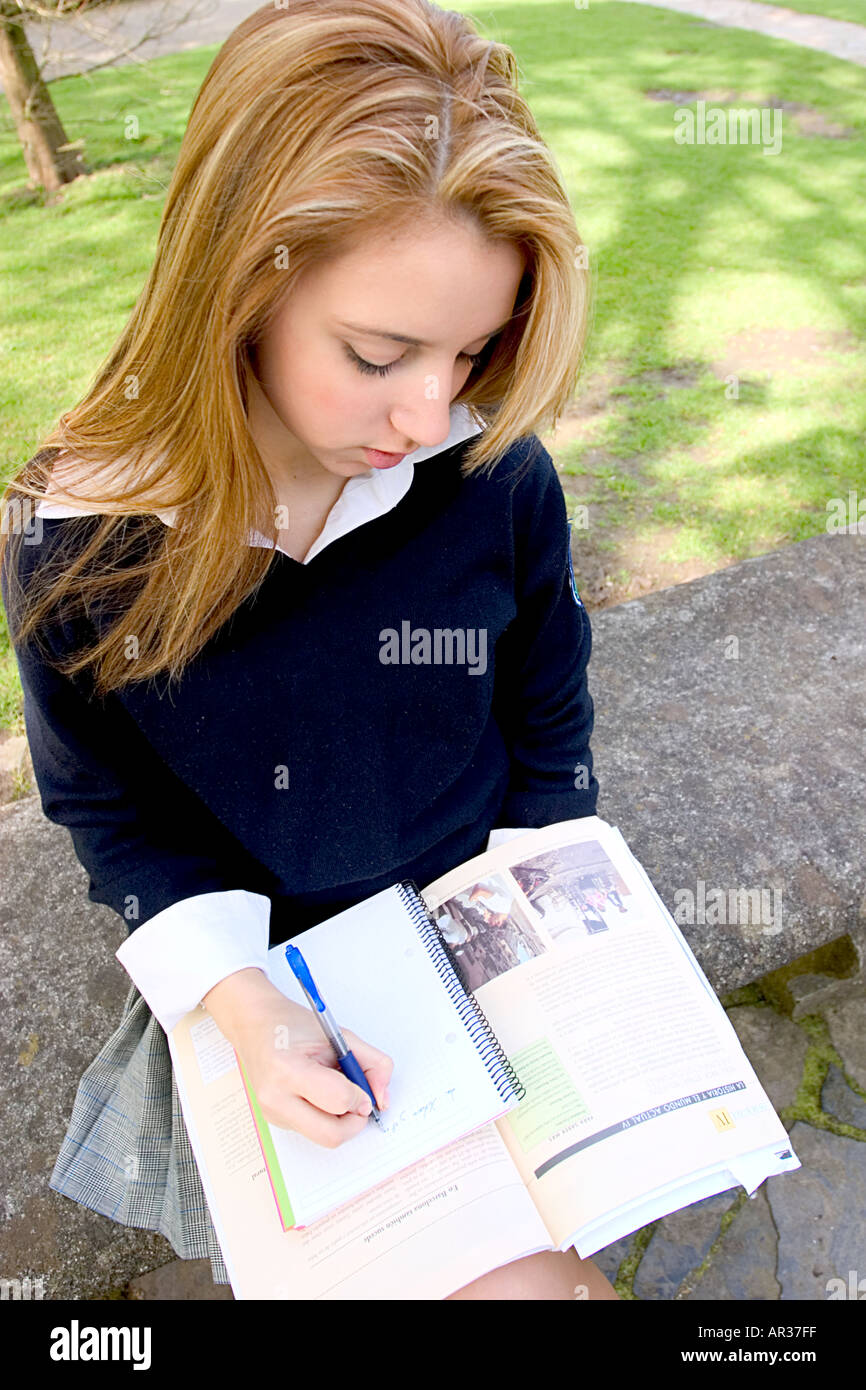 Teenage Blonde Schoolgirl Studying In The Park And Looking Desperate