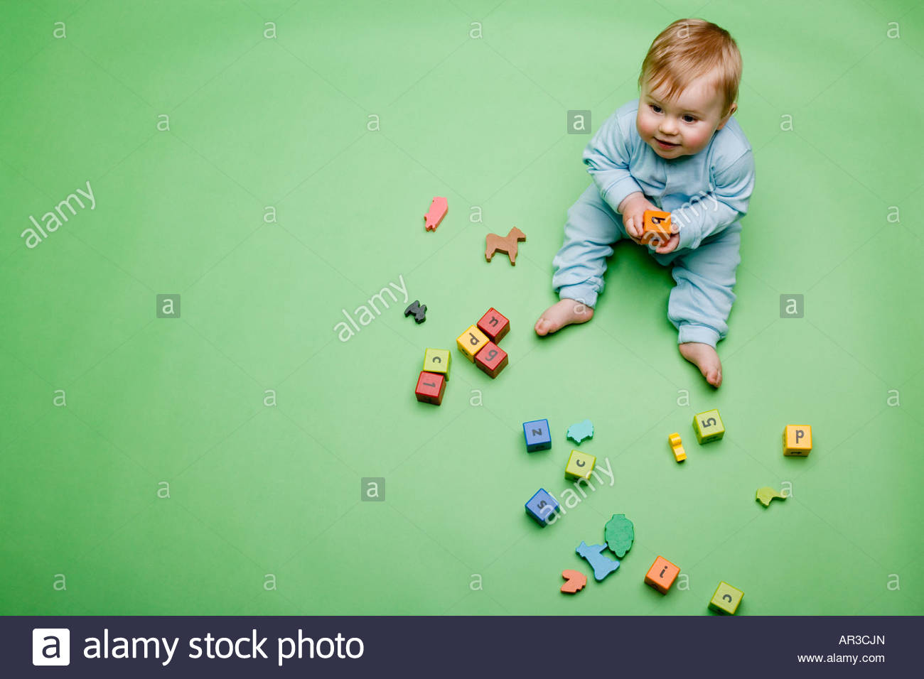 Baby boy with building blocks - Stock Image