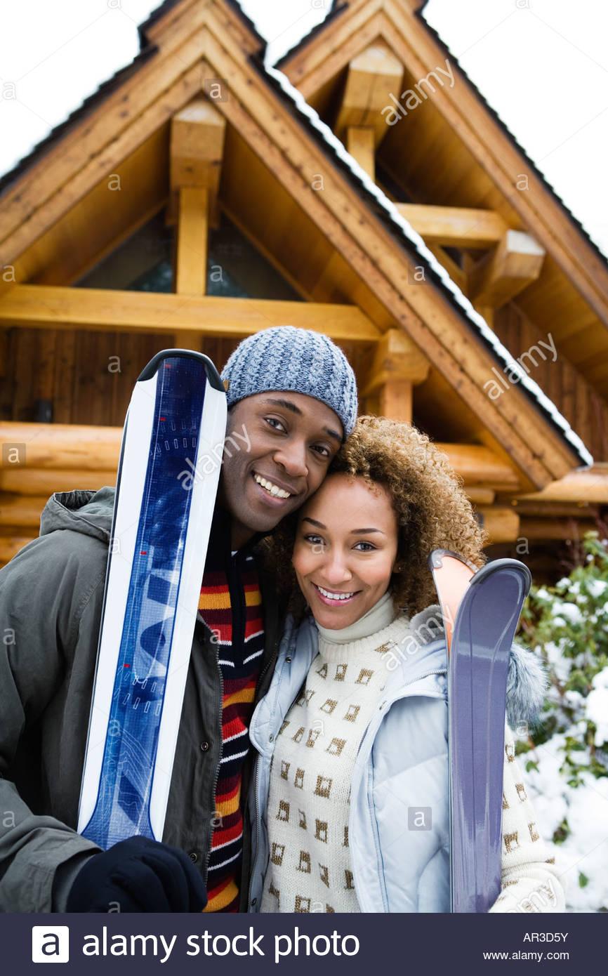 Portrait of a couple in skiwear - Stock Image