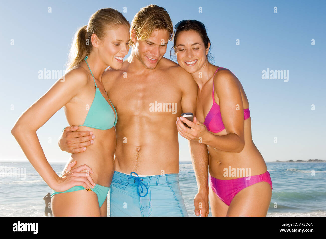 Woman showing camera to friends - Stock Image