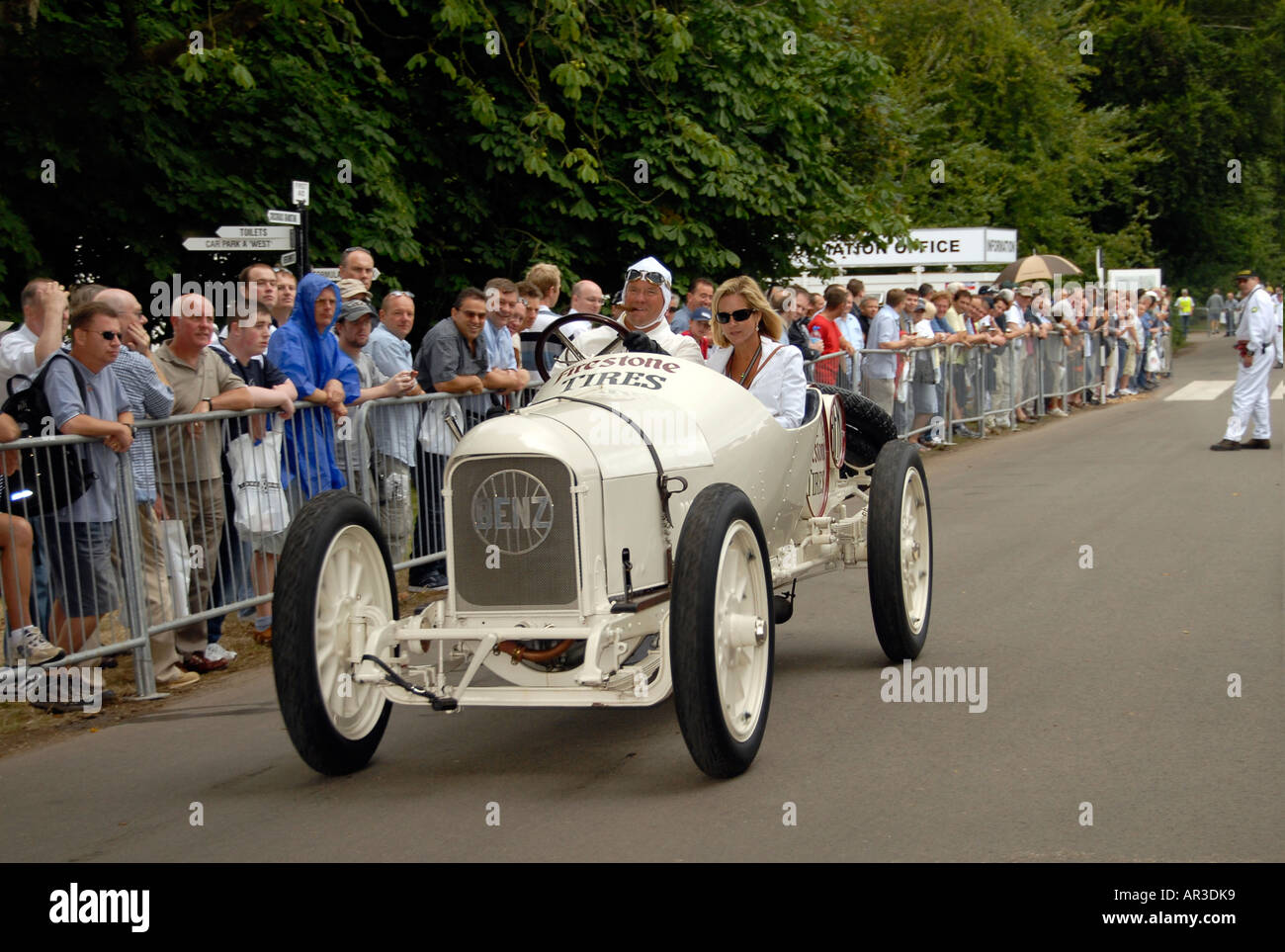 Racing Mercedes car at Goodwood track revival day watched by spectators - Stock Image