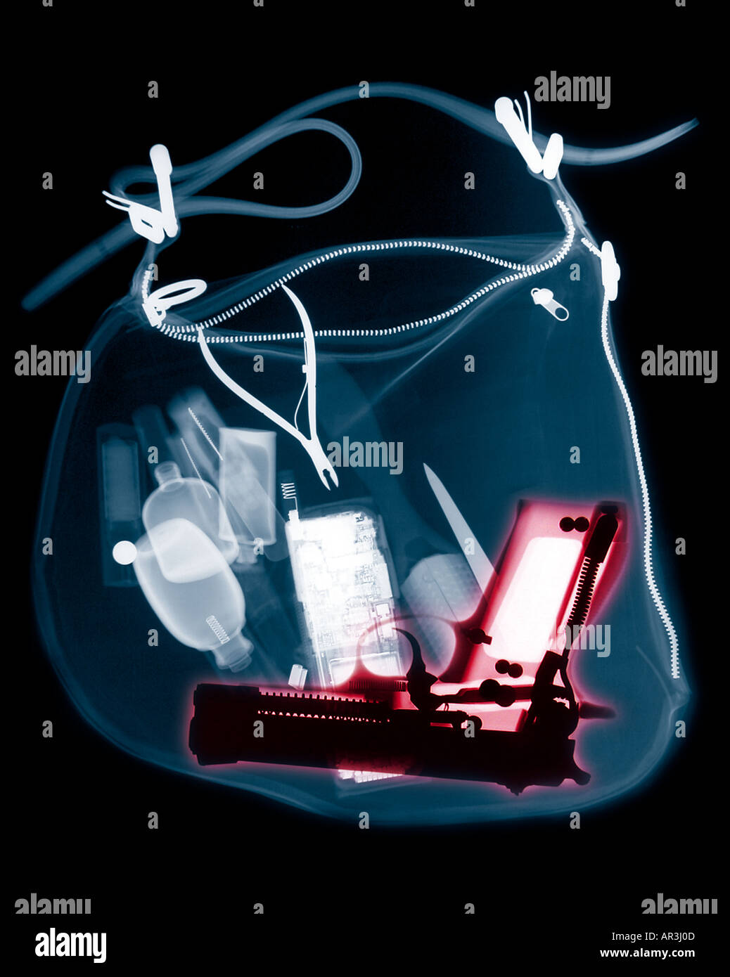 Xray of a woman s handbag showing several items that are not permitted to be carried aboard an aircraft after the 9 11 terrorist - Stock Image