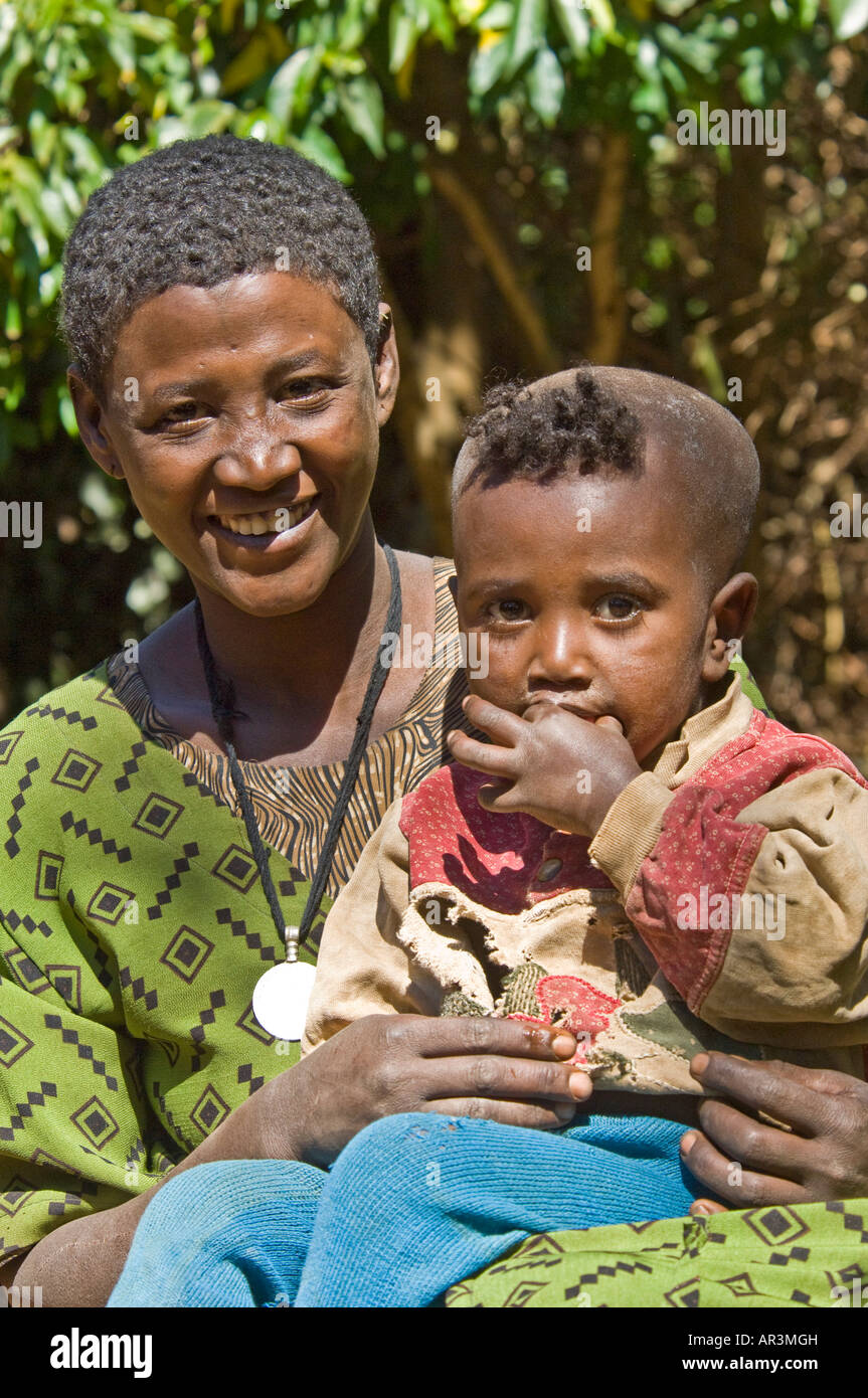A local woman and her baby pose for the camera at their home near the Ura - Kidane Mihret Monastery. - Stock Image