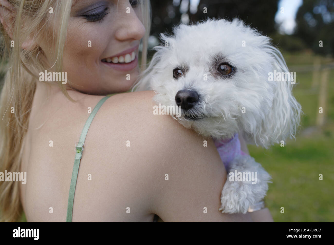 Young woman and pet dog in park - Stock Image
