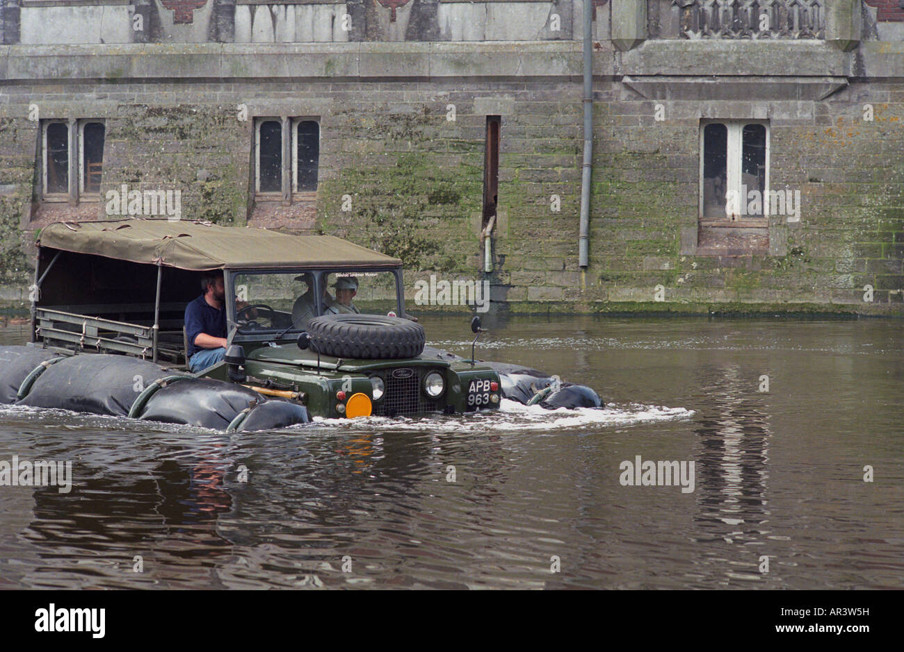 Historic 1963 APGP amphibious Land Rover with flotation bags swimming to commemorate Land Rovers 50th anniversary Stock Photo