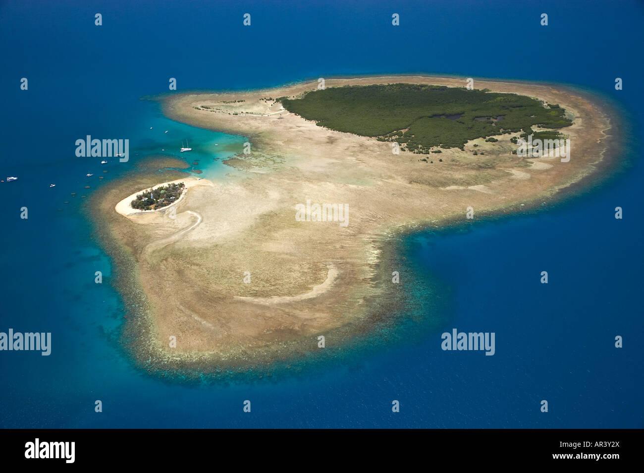 Low Isles reef in shape of map of Australia Great Barrier Reef Marine Park near Port Douglas North Queensland Australia - Stock Image