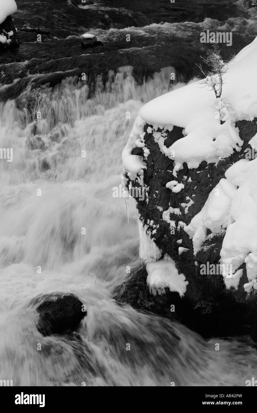 Yellowstone National Park Madison River waterfall rapids in winter snow and ice - Stock Image