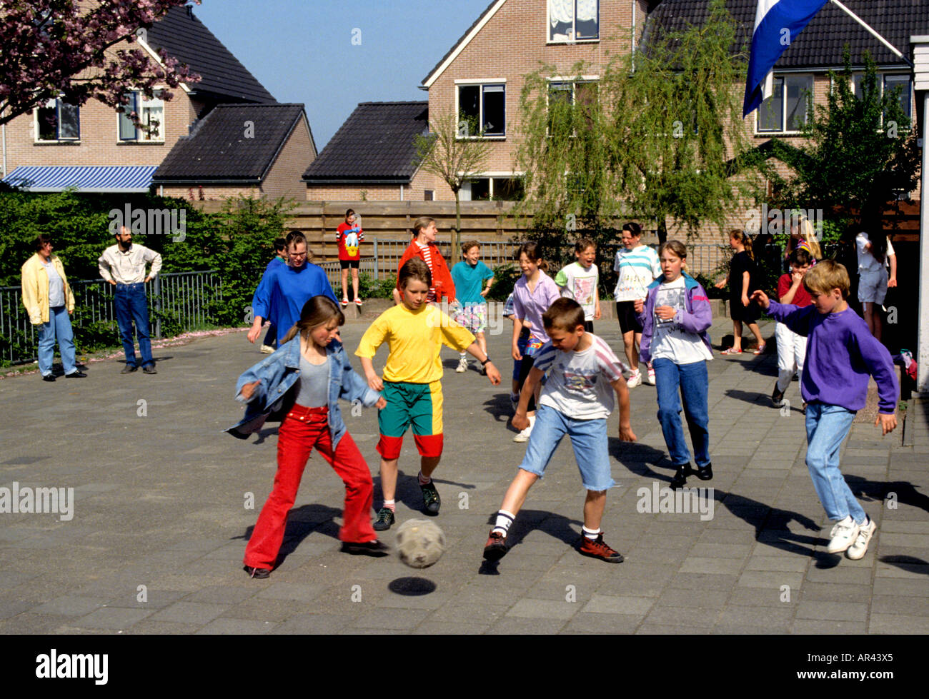 Netherlands Holland  school yard play ground lay football soccer ball player - Stock Image