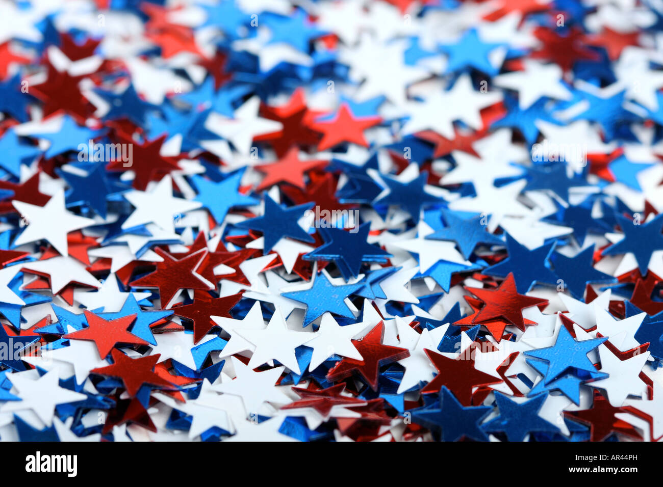 Star shaped confetti perfect as a election or 4th of july background focus on stars in front - Stock Image