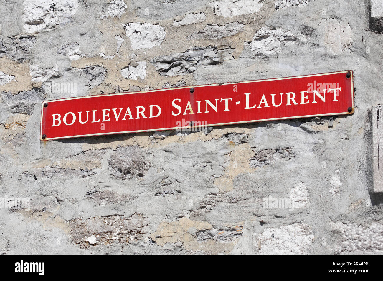 Street sign of Boulevard Saint Laurent on the side of a building in Old Montreal Montreal Quebec Canada - Stock Image