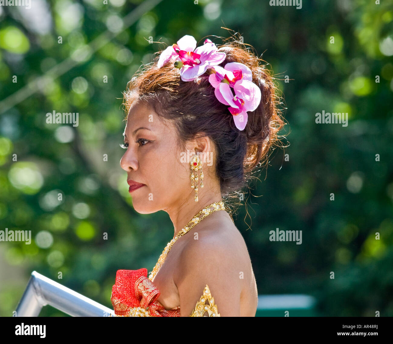 Woman In Traditional Thai Dress With Floral Hair Arrangement