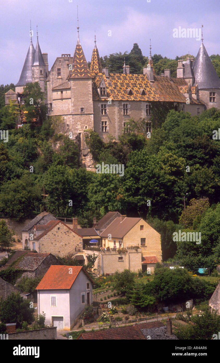 Typical chateau,traditional patterned,tiled roof in Beaune,France,Burgundy,castle with turrets and spires.surrounded by trees - Stock Image