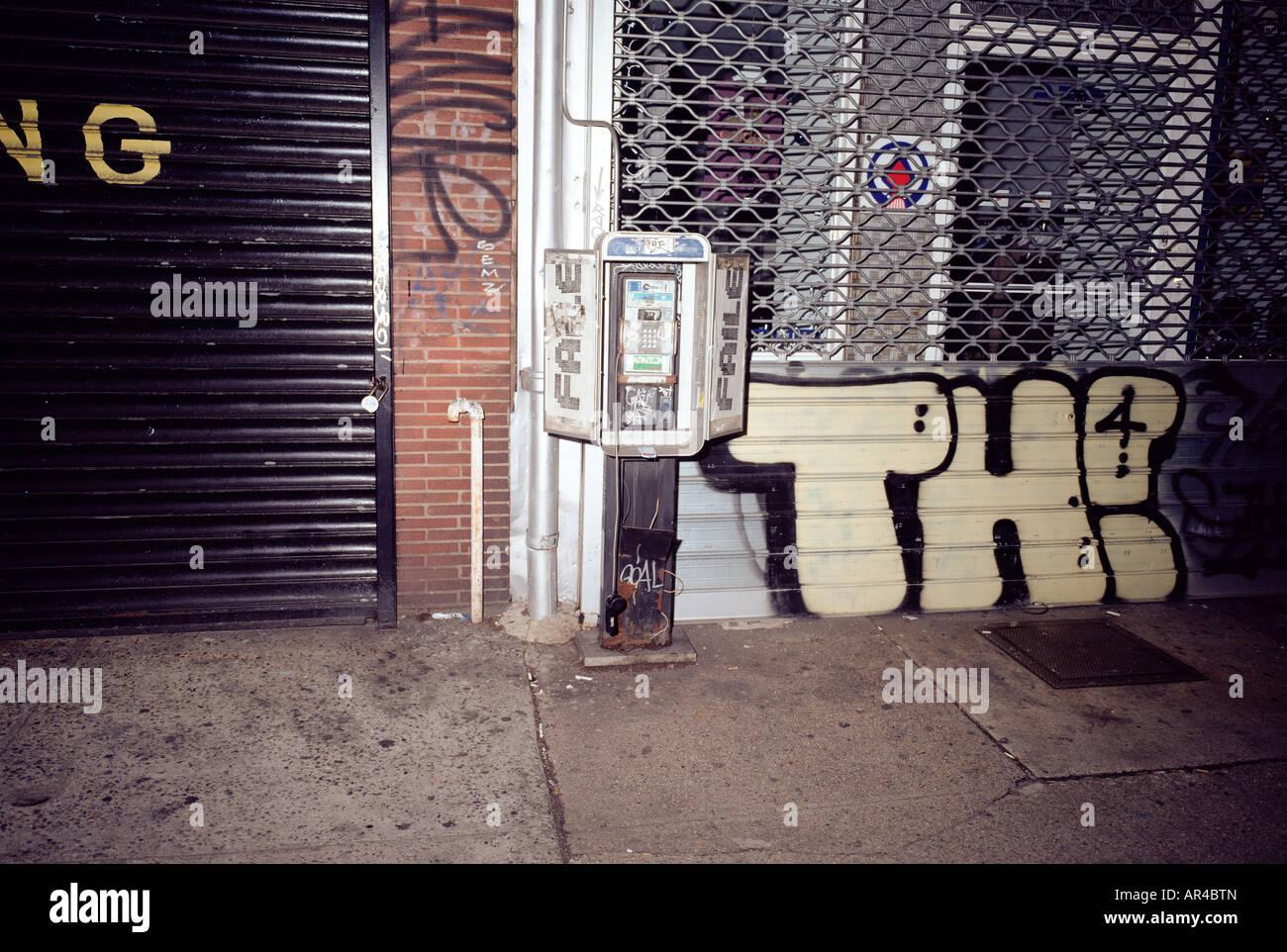 Graffiti and vandalised payphone - Stock Image