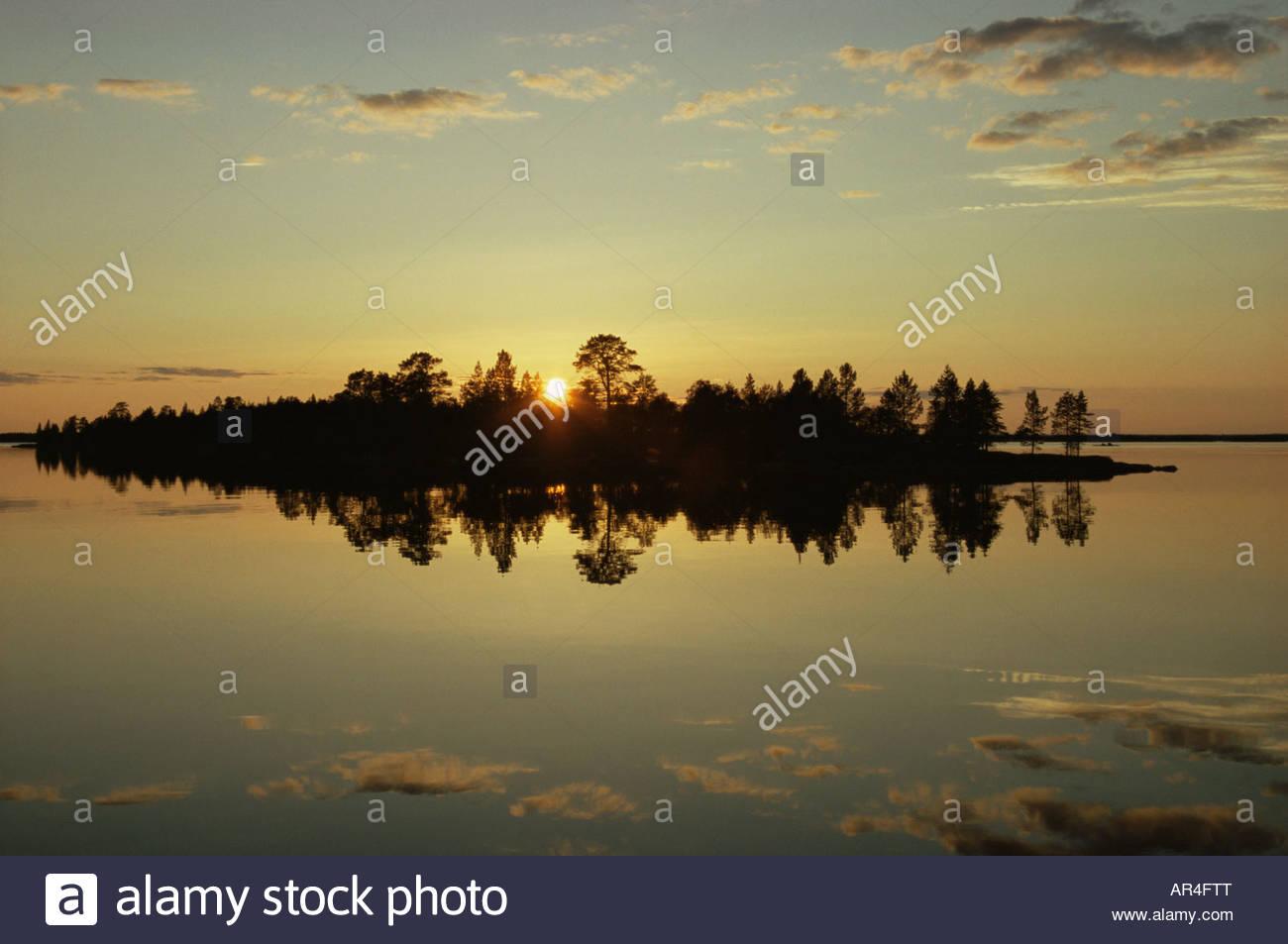 Midnight sun at lake inari finland - Stock Image