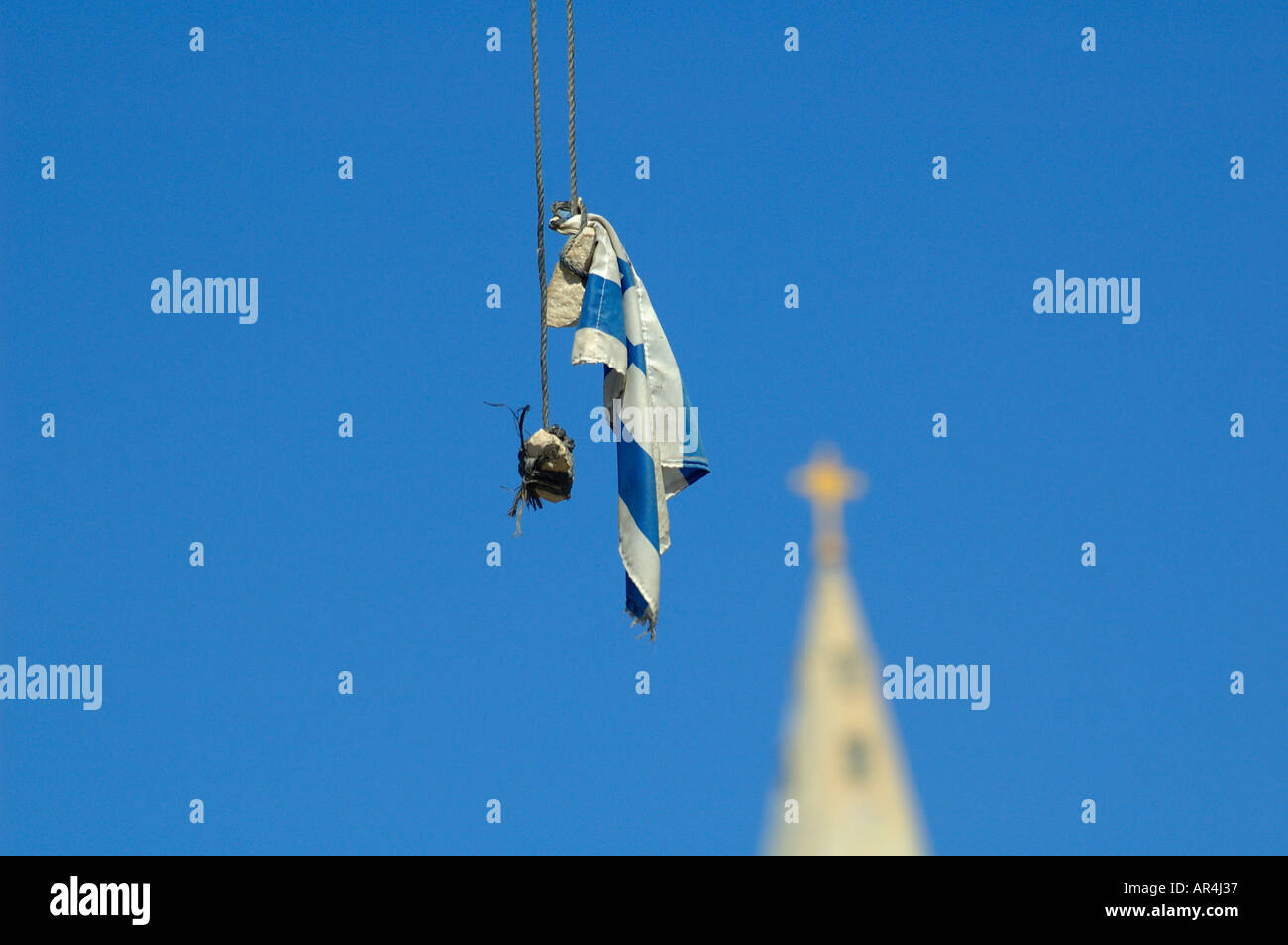 Israeli flag hanging off electric cable in East Jerusalem during Intifada riots, Israel - Stock Image