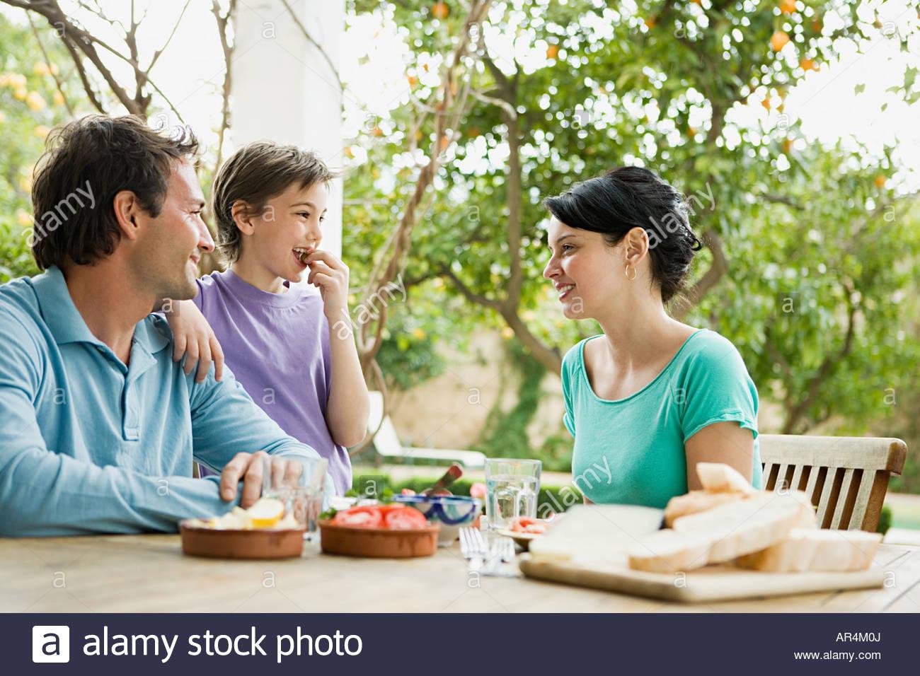 Family having an alfresco meal - Stock Image