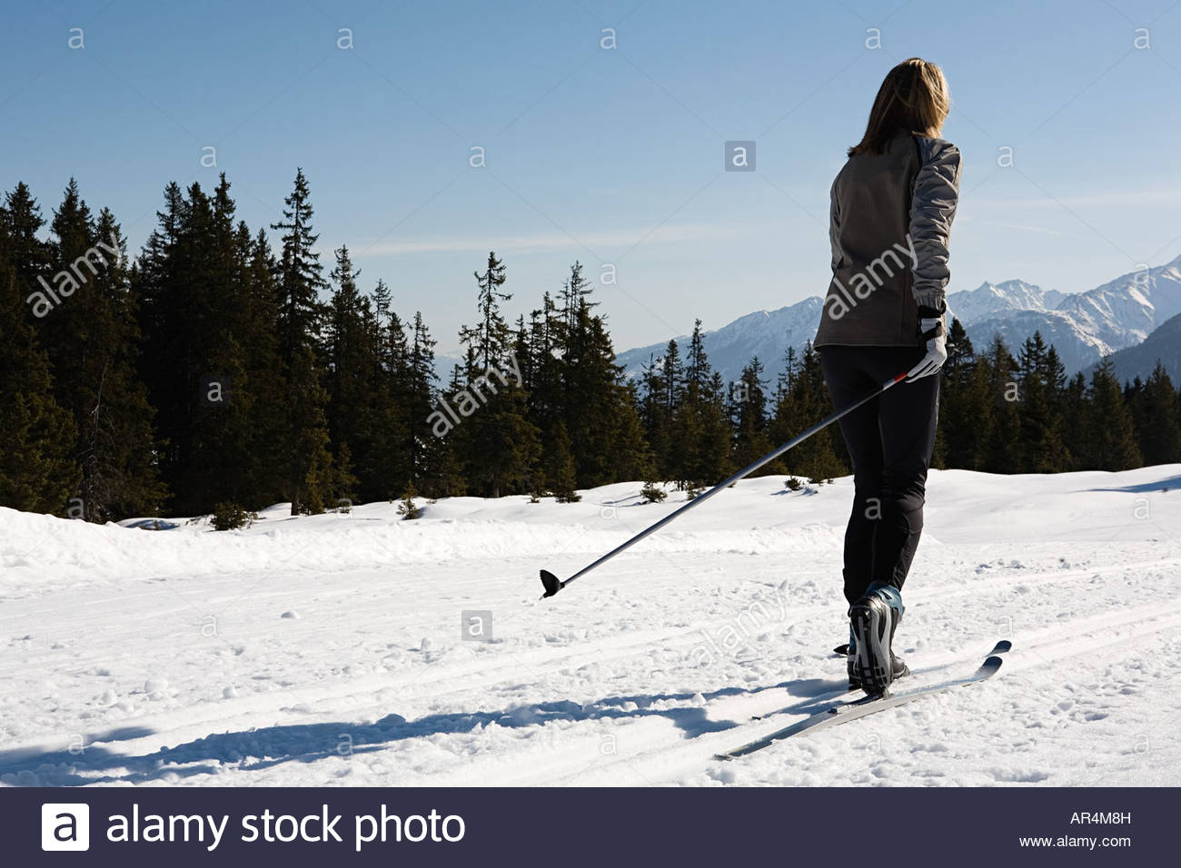 Woman cross country skiing - Stock Image