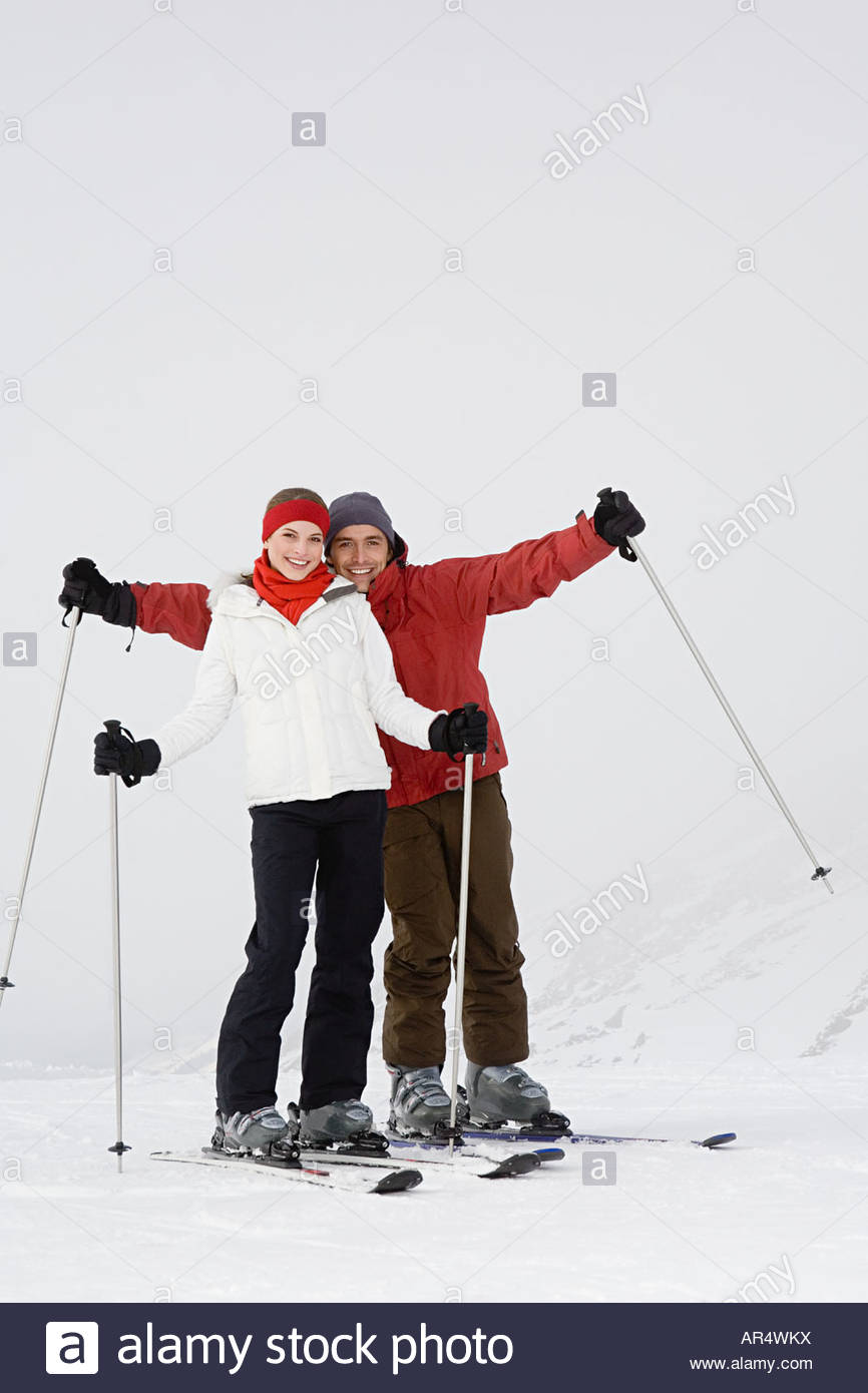 A couple skiing - Stock Image