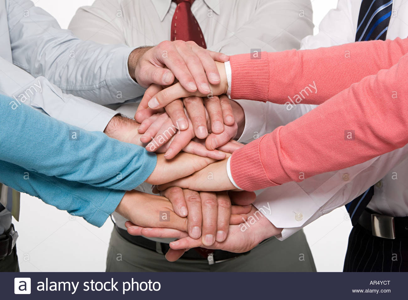 Colleagues hands on top of each others - Stock Image