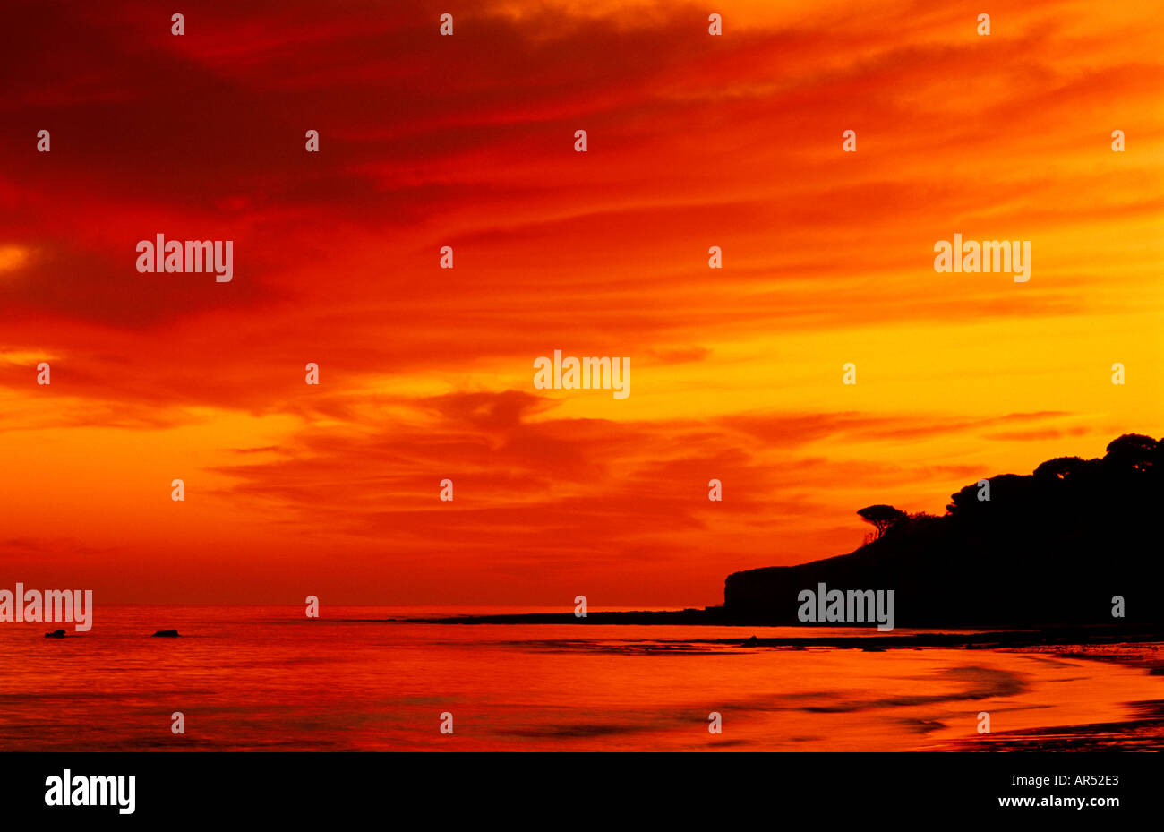 Sundown at beach Olhos de Agua Albufeira Algarve Portugal - Stock Image