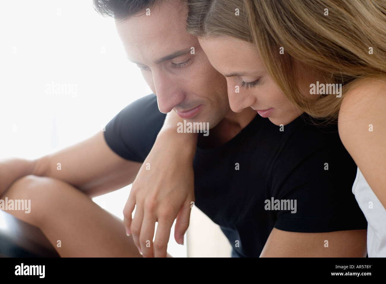Couple looking down - Stock Image