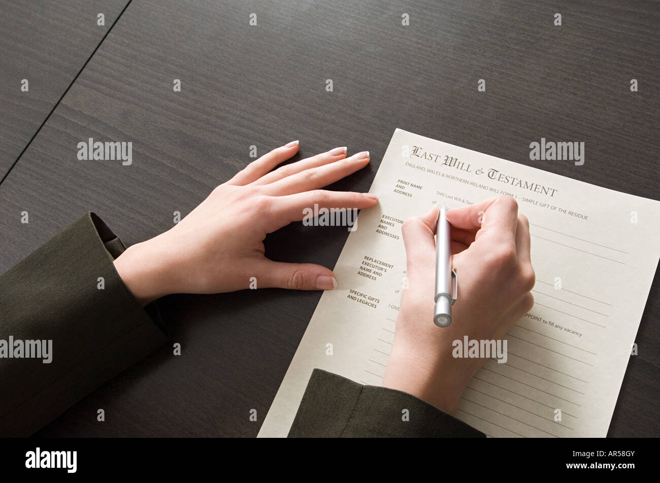 Woman signing will - Stock Image